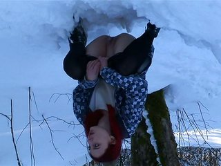 Redhead hot white youngster in the winter forest pulls embarrass her nylons and pisses